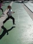 Kids running across the shuffleboard courts